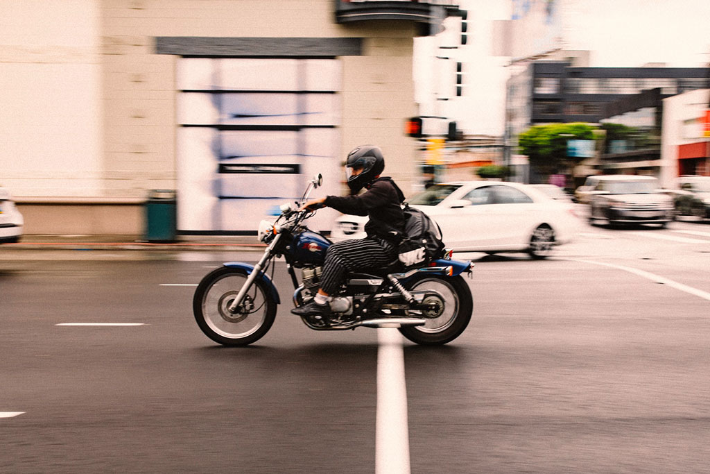 man riding motorcycle practicing motorcycle safety